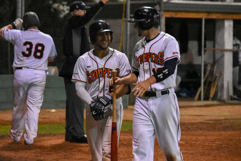 Rayson Romero (left) and Kenny Meimerstorf (right) smile after taking the lead in the eighth inning of the Sonoma Stompers game against the Vallejo Admirals, August 24, 2018 in Sonoma, Calif.(James W. Toy III / Sonoma Stompers)