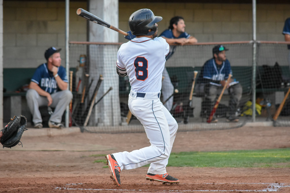 Rayson Romero follows through on his home run in the second inning of the Sonoma Stompers game against the San Rafael Pacifics, August 30, 2018 in Sonoma, Calif.(James W. Toy III / Sonoma Stompers)