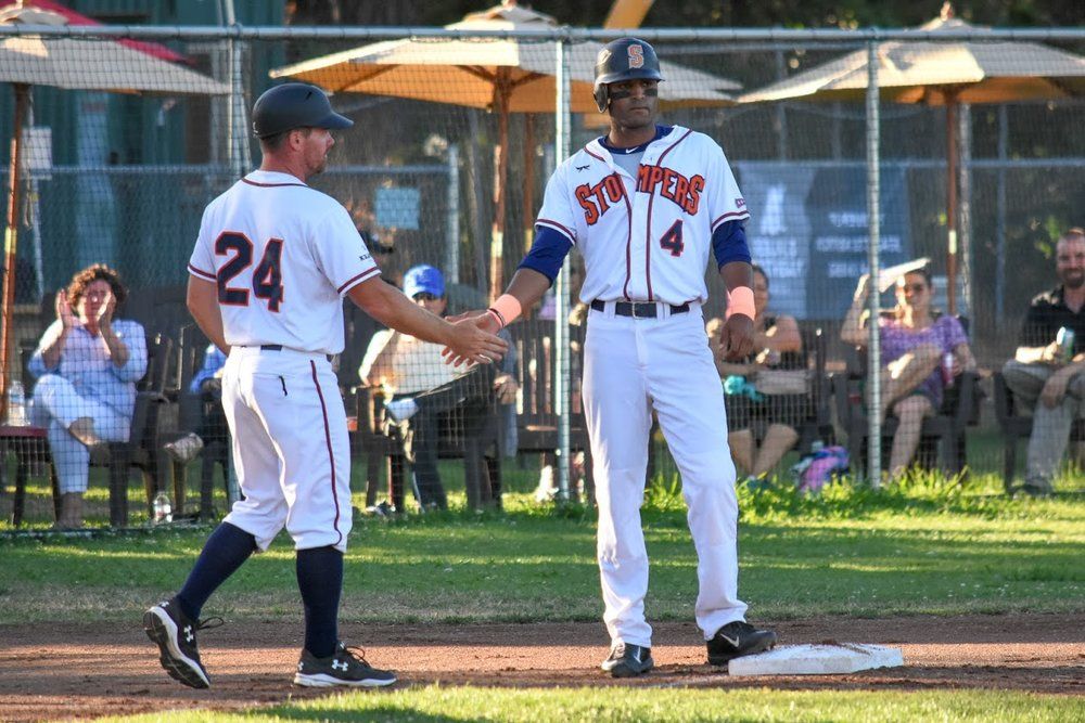Manager Zack Pace congratulating Marcus Bradley in a home game, 2018 in Sonoma, (James W. Toy III / Sonoma Stompers)