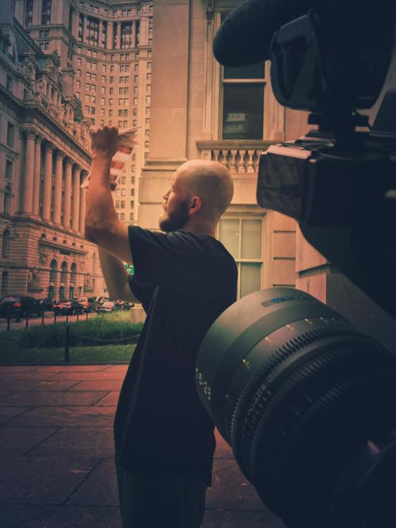 BTS of the final key scenes I shot for the film,Daniel looking at 35mm film negatives he shot with his vintage camera, that I filmed on the  Tokina 16mm-28mm Vista Zoom . The great location of City Hall added as a nice backdrop!