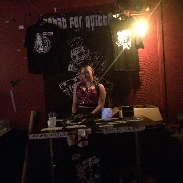 The rehab for quitters Merch booth.  Come get your CDs and Ts at our next show.  The lovely Lauren spike helped us out last night. @unspoileddream #rehabforquitters #rocknroll #merch #girl #pretty #sexy #live #cds #toomanyhashtags #toobadyoumissedit