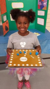 Miracle from CYC's Crown Center shows     off the game board she created in the CYC Maker Lab, a creative and technical workshop that teaches STEAM skills
