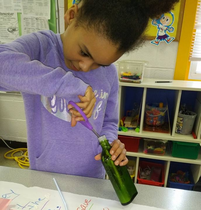 Amara works on a prototype of the double-sided lotion invention.