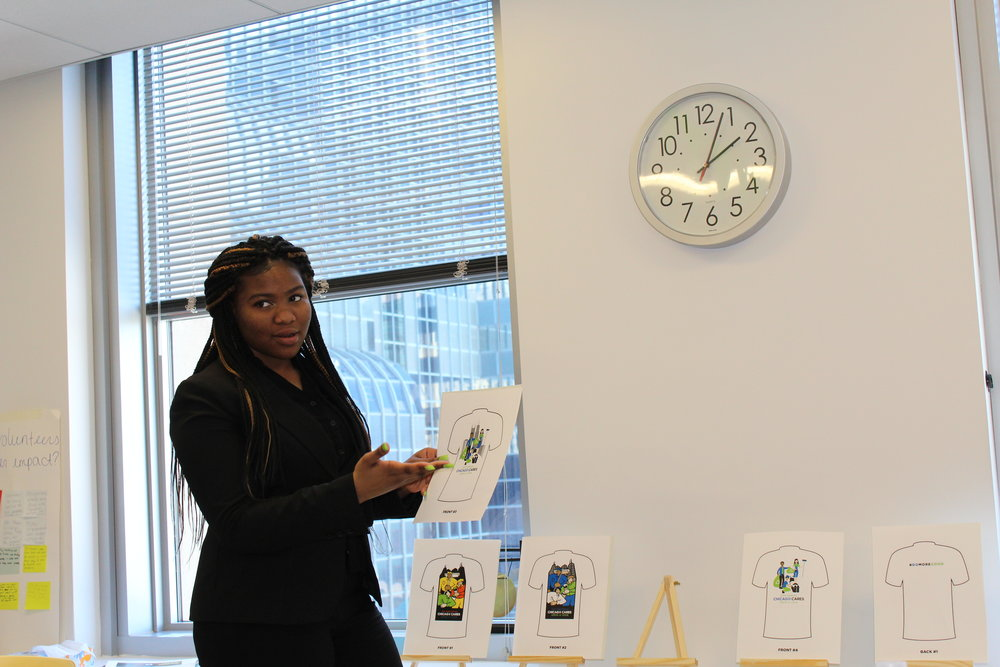 Janese, a CYC-Fellowship House teen, explains various design options to the executives at Chicago Cares.