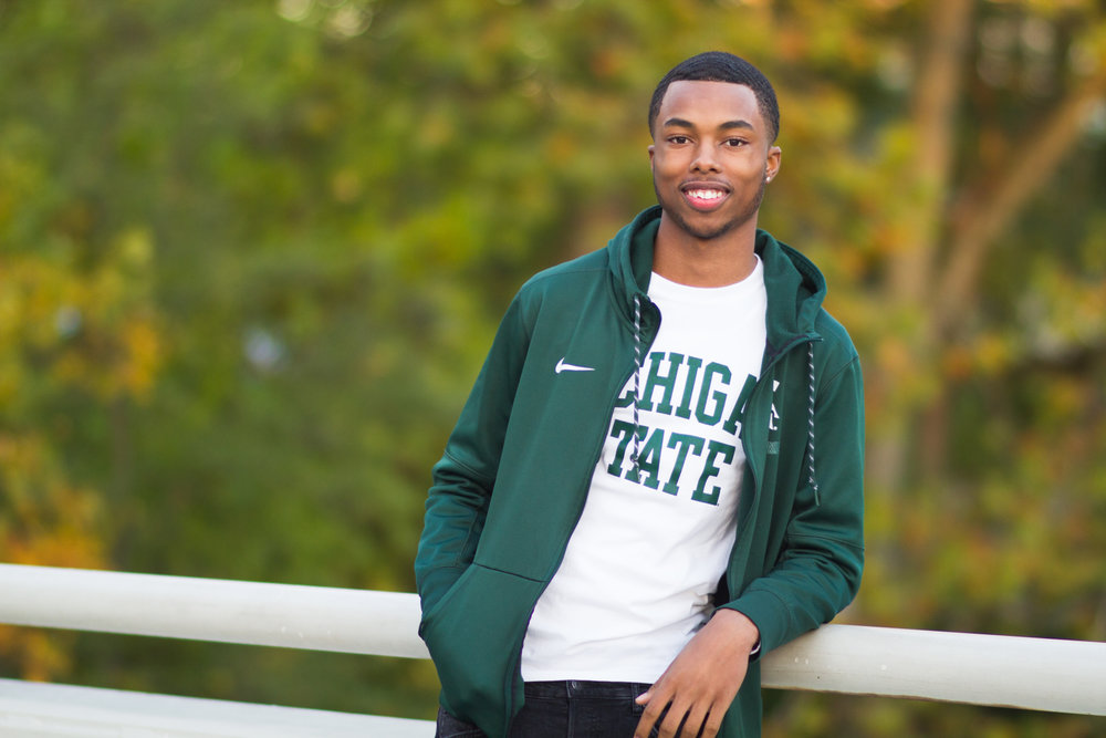 Maurice poses on the Michigan State University campus.