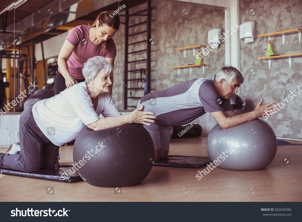stock-photo-senior-people-workout-in-rehabilitation-center-personal-trainer-helping-senior-people-on-pilates-653635384.jpg