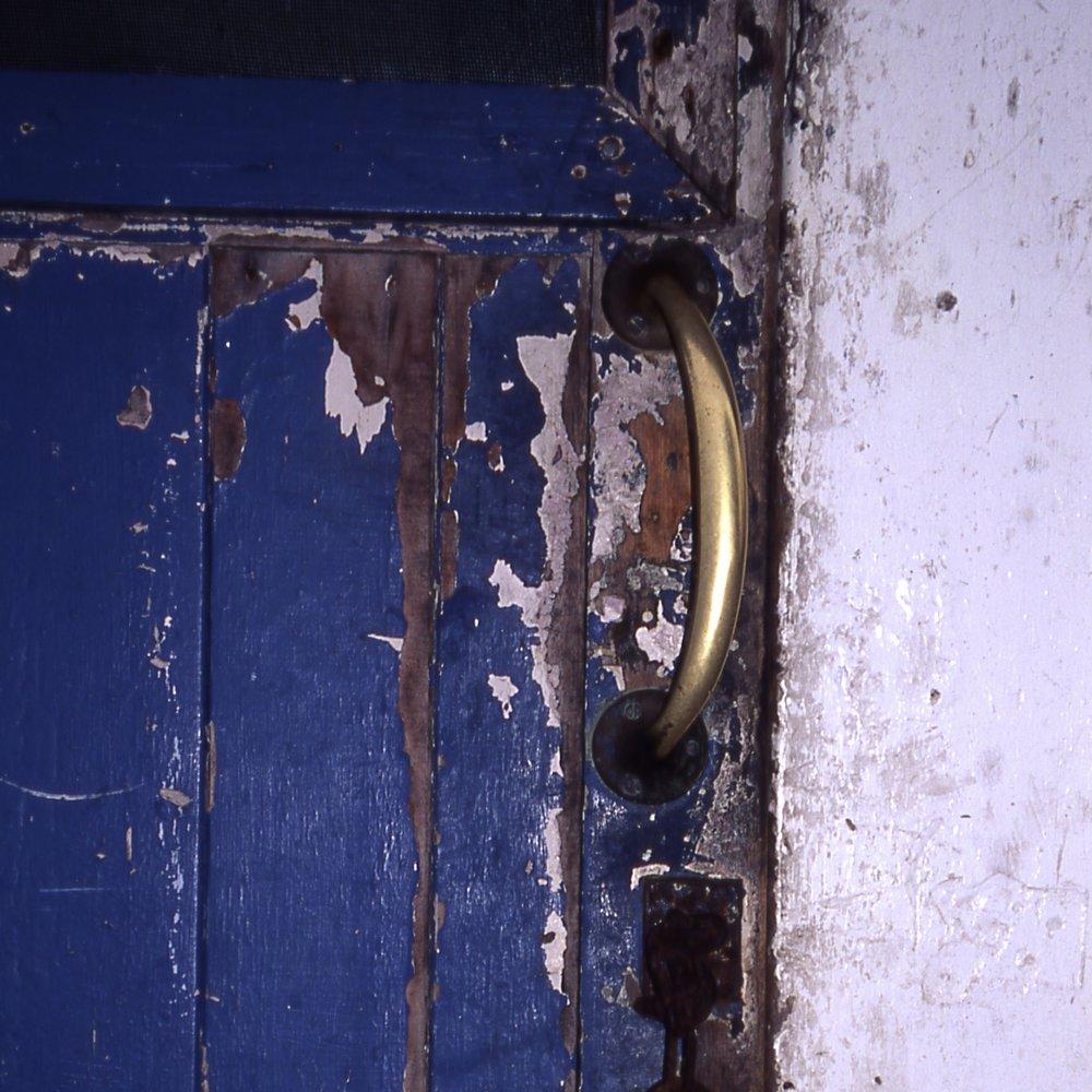 Allow the paint to chip off the door. Instead, open the door and explore deep inside.