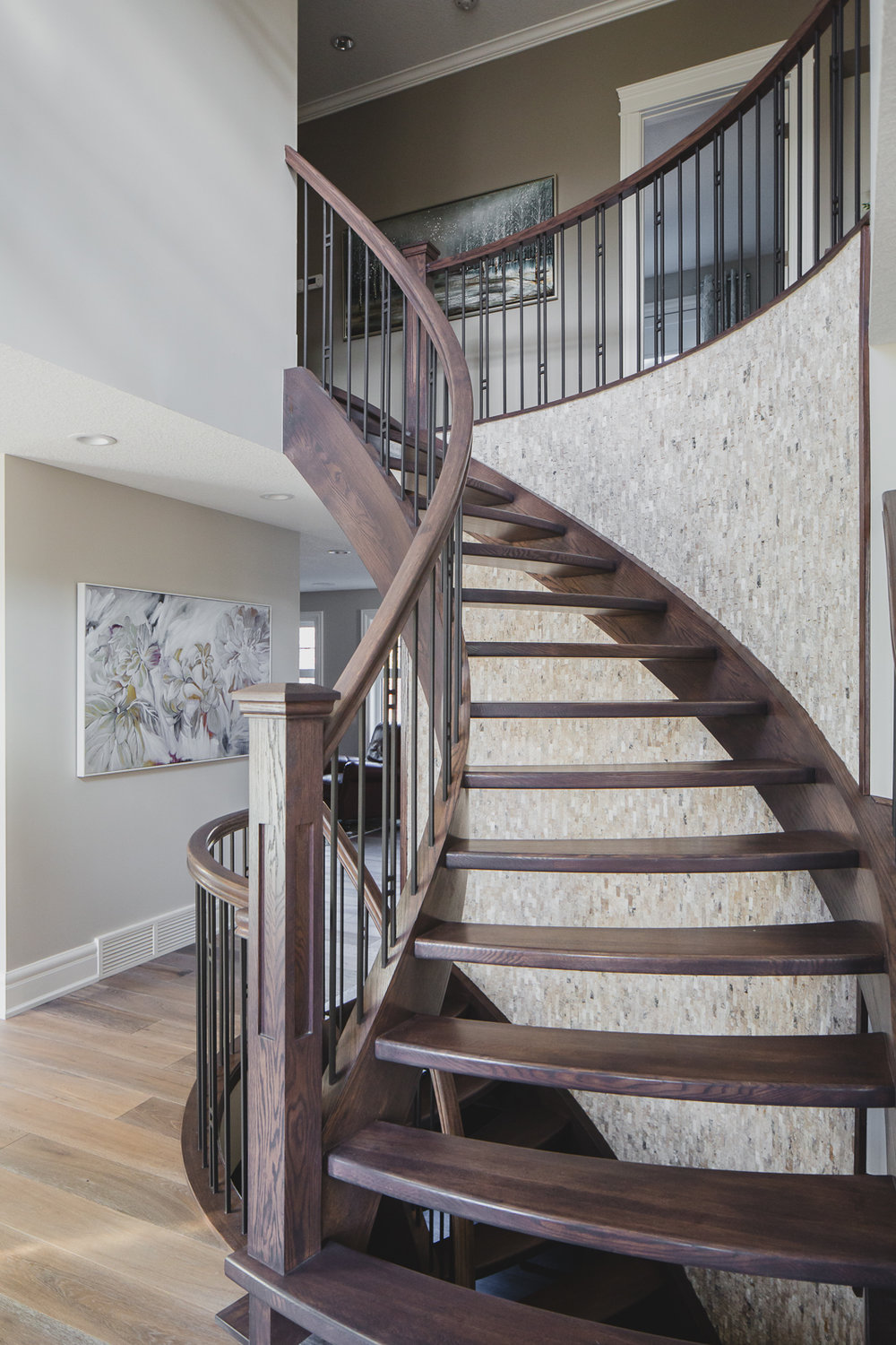 Open Riser staircase with stone accent wall