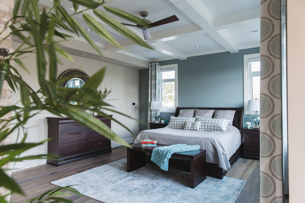master bedroom with cofferred ceiling