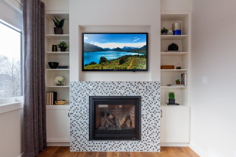 Fireplace with built-ins and TV.