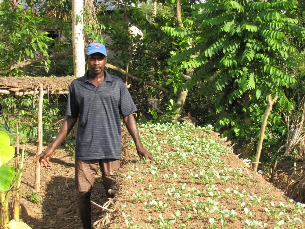 OPMAGAT farmer with peppers and cabbage
