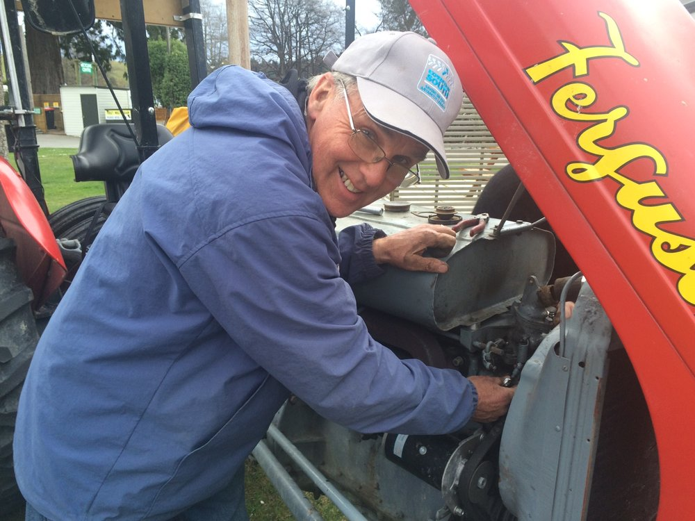 Brian working his magic on the tractors. Every evening, he can be found tinkering with them. Al thinks Brian is making his tractor slower by a very small amount every day. Either way, the tractors haven't broken down for weeks, so we're grateful to have Brian with us.