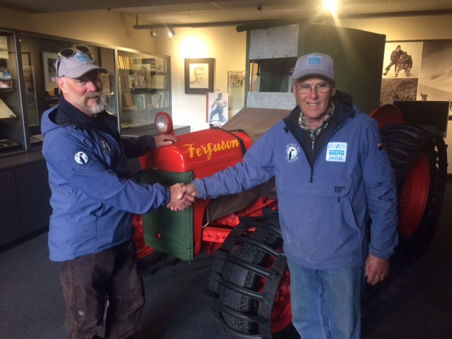 Al and Brian in front of the replica Fergie tractor at the Hermitage Hotel