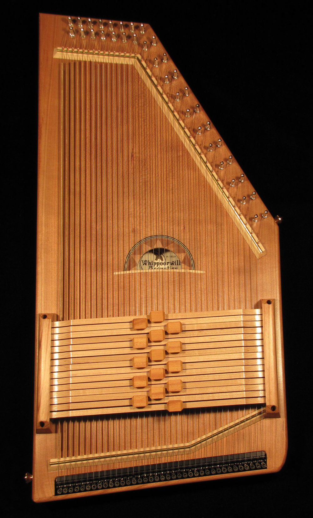 Order your Heartland Autoharp Today!$1600 - Quarter-sawn cherry top and sitka spruce back. Fifteen maple chord bars.Osage Orange chord bar buttons in three rows. Fine tuners.High-quality padded case.Distinctive sunset sound hole design.Endorsed by Jo Ann Smith with autographed label.Incredibly light and comfortable to hold and play.Bright, clear, sweet tone with plenty of volume.Four-key Chromatic, two-key diatonic or single-key diatonic setups.Custom setup consultation with Jo Ann included.Optional: Lock bars ($25 each) magnetic pickup ($200)