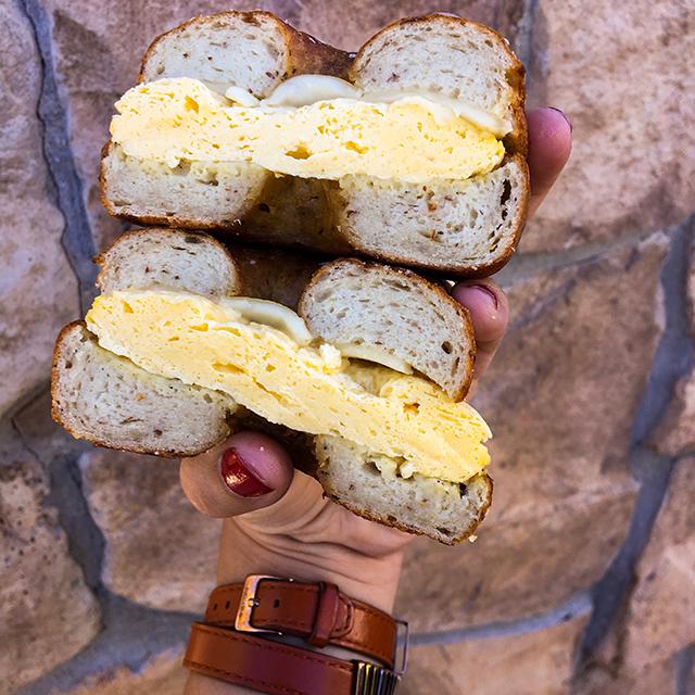 Breakfast Sandwich - Hand rolled pretzel buns (gluten free, dairy free, soy free, nut free, vegan), egg, and vegan mozzarella cheese.