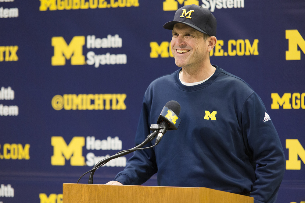 In just a year and a half on the job as Michigan's head football coach, Jim Harbaugh has made no guarantees, no bold proclamations or grand predictions. He's made everyone else do it for him.