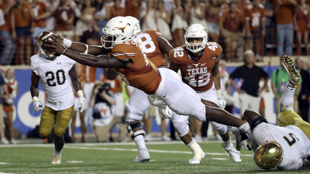 Texas QB Tyrone Swoopes dives for the game winning touchdown in double overtime against Notre Dame.