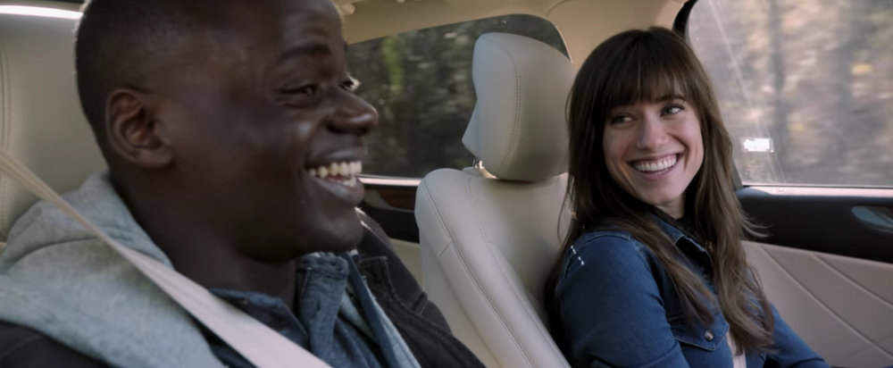 Chris (Daniel Kaluuya) and his girlfriend Rose (Allison Williams) are on their way to stay with her family for the weekend. This might be the happiest his character is in the whole movie and it's about five minutes in.