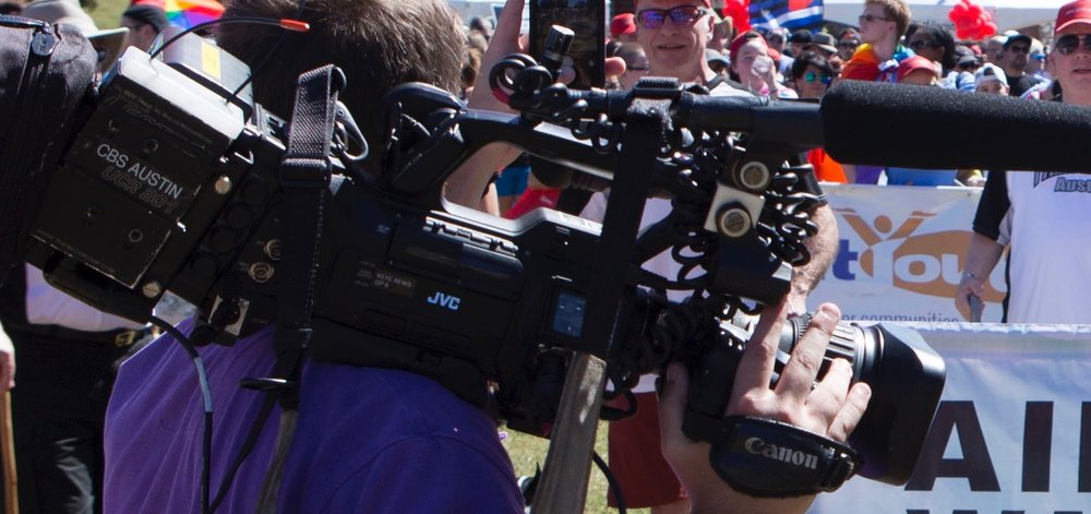 Several local news outlets, including CBS Austin, make an appearance to cover the annual AIDS Walk Austin.