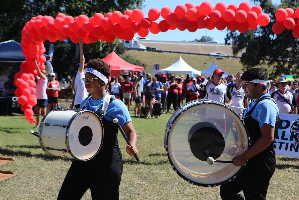 With the pounding of the drums by the SOUL band, the 28th annual 2.75 mile AIDS Walk Austin march officially begins.