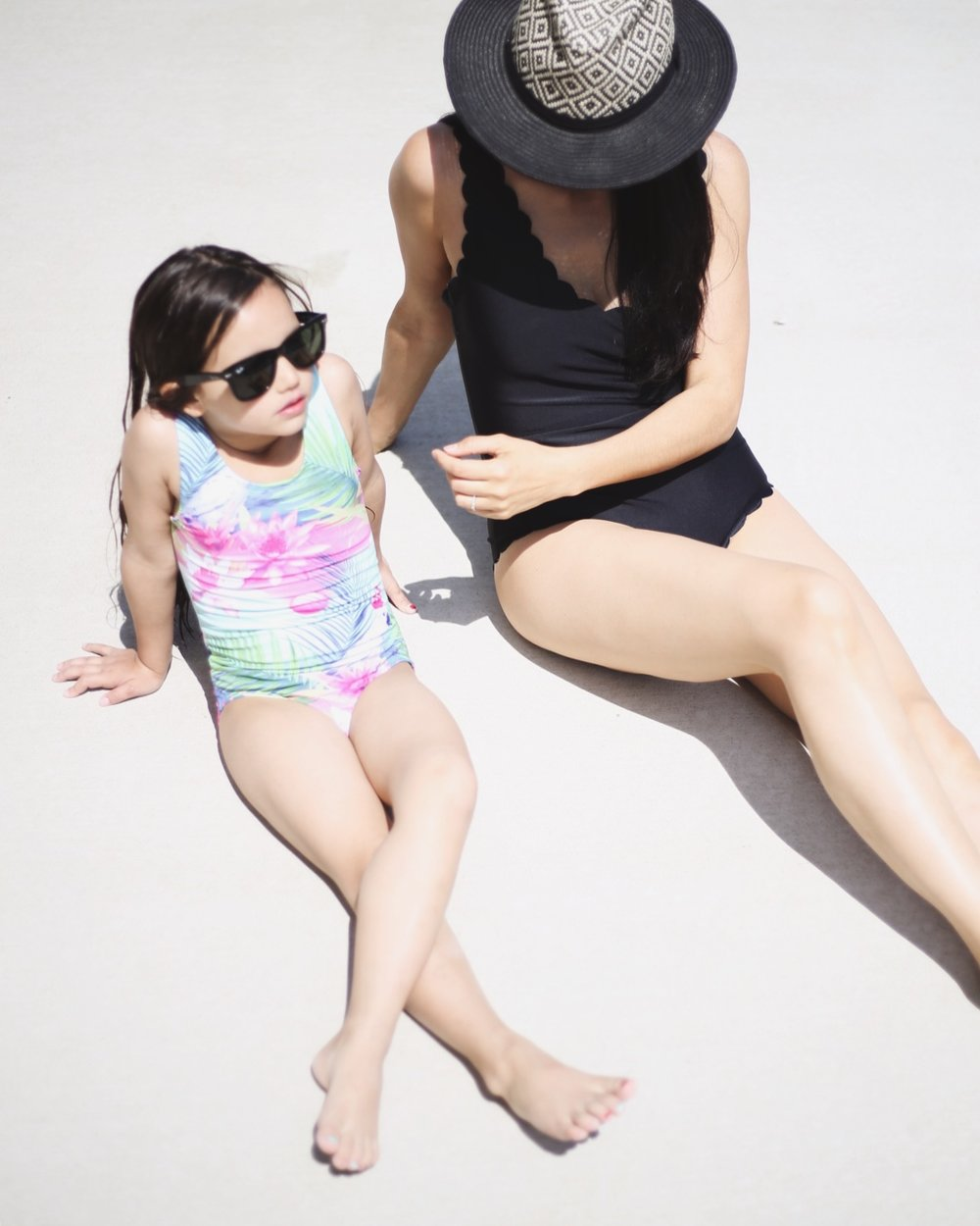 |  girl swimsuit similar  | girl  sunnies  |  scalloped one piece  |  hat similar  | image: Sydney Clawson |