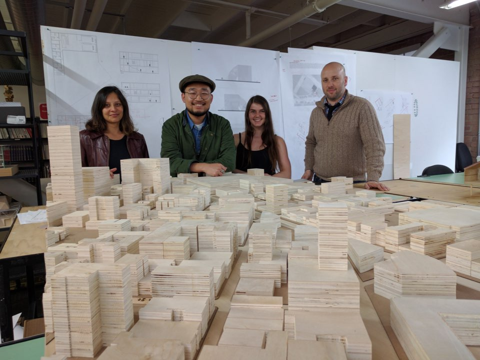 Sameena Sitabkhan (left), Doron Serban (right), and two students display a model they created of the entire Tenderloin, to help inform their designs for alternative homeless shelters. (Photos: Brittany Hopkins/Hoodline)