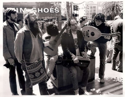 Photo by Harold Adler: Allen Ginsberg with members of the Cockettes and Magic Theater, demonstrating in Union Square.