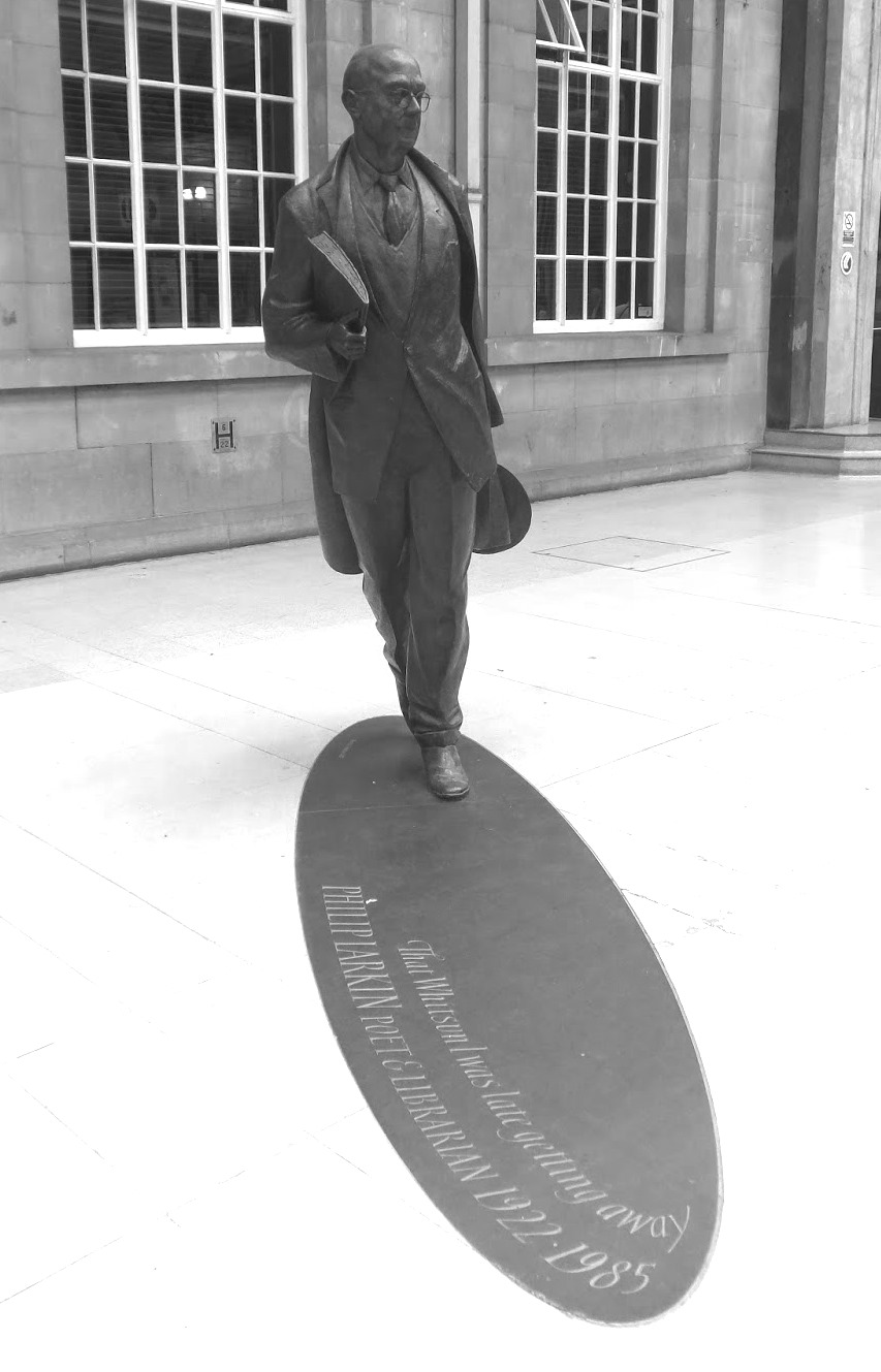 "Larkin statue sauntering through the train station of his ""other"" home, Hull."