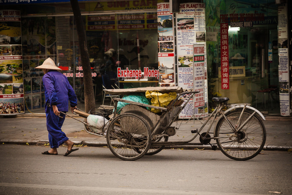 Photo by Kerry Warnholtz -  Eking Out a Living , Hanoi, Vietnam © Kerry Warnholtz 2015