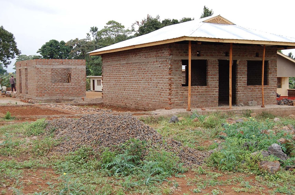 Construction of boys' hostel dorm and classroom in the background.