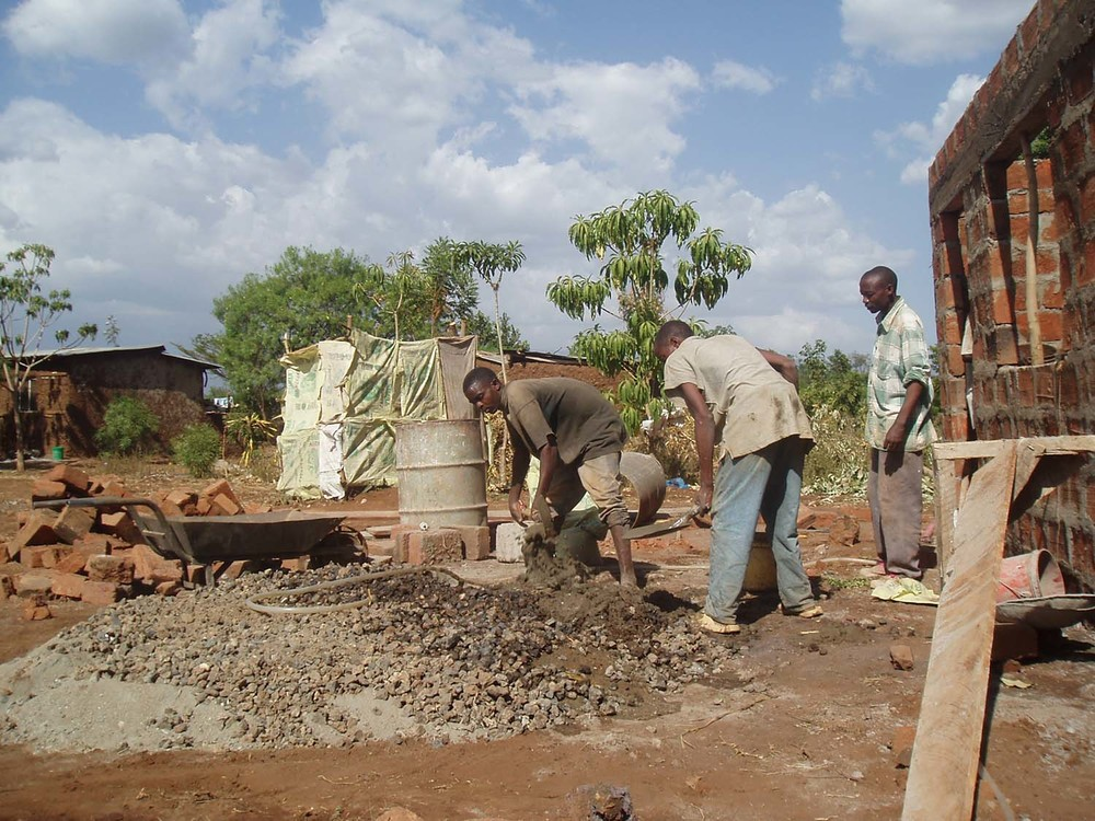 Hard at work on the construction of our kitchen block.
