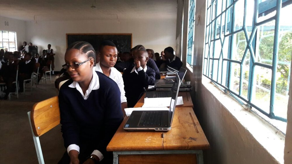 students with the donated laptops