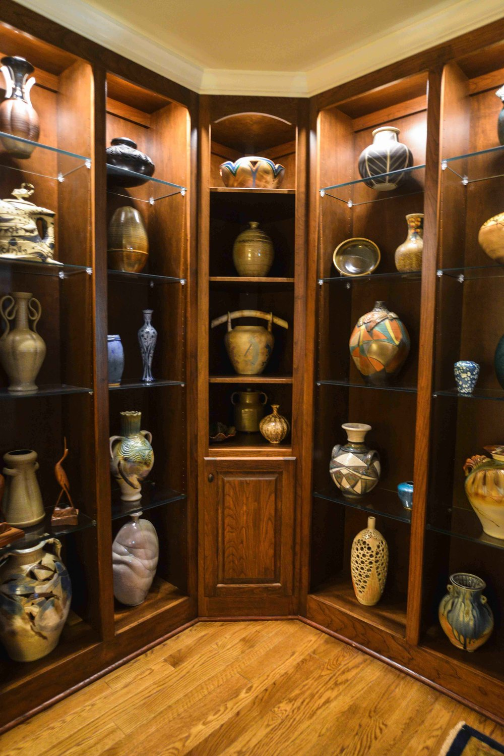 180 Spaces | Interior Design Turnarounds.... Custom designed walnut display cabinet for a special client's pottery collection from Seagrove, NC