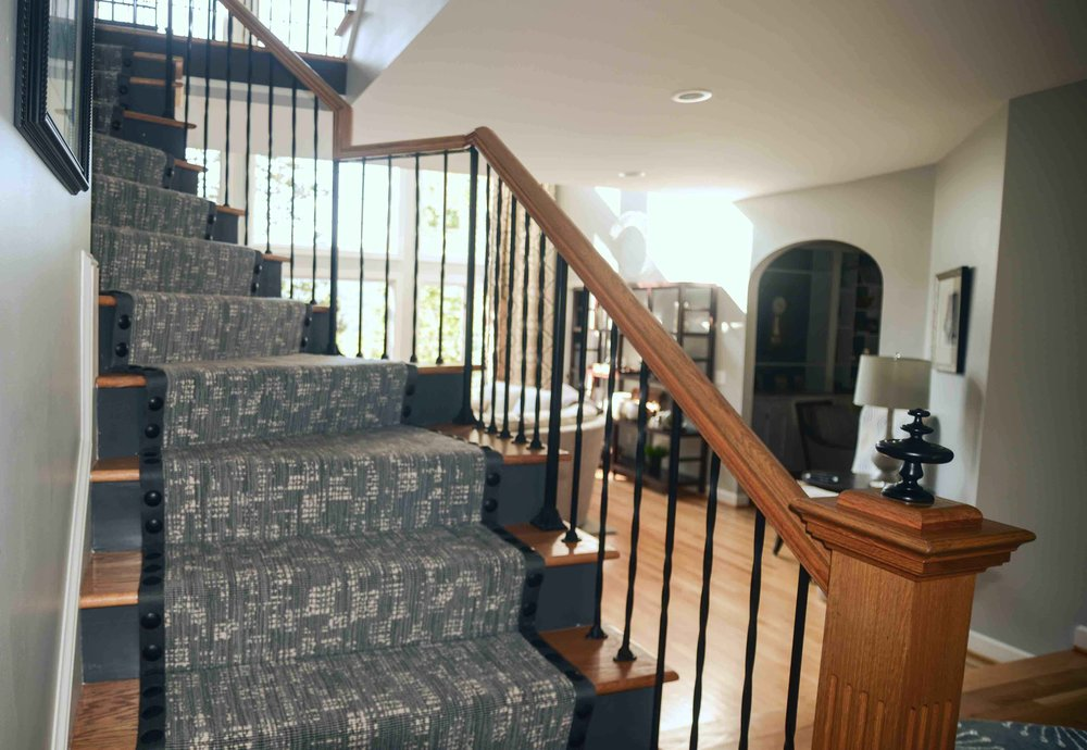 180 Spaces | Interior Design Turnarounds -  Curved stair detail featuring banded carpet runner with enlarged, hammered nail head trim. @Stark Carpet