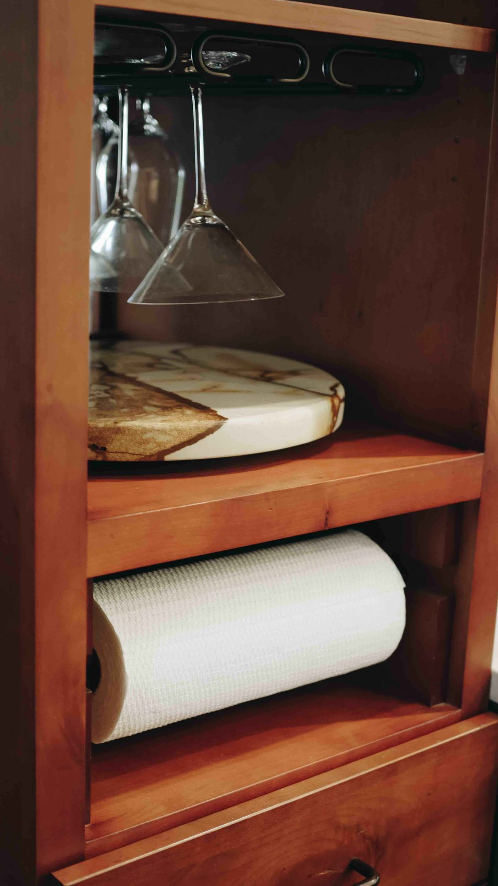 180 Spaces | Interior Design Turnarounds - Accessible yet tucked-away paper towel cubby !