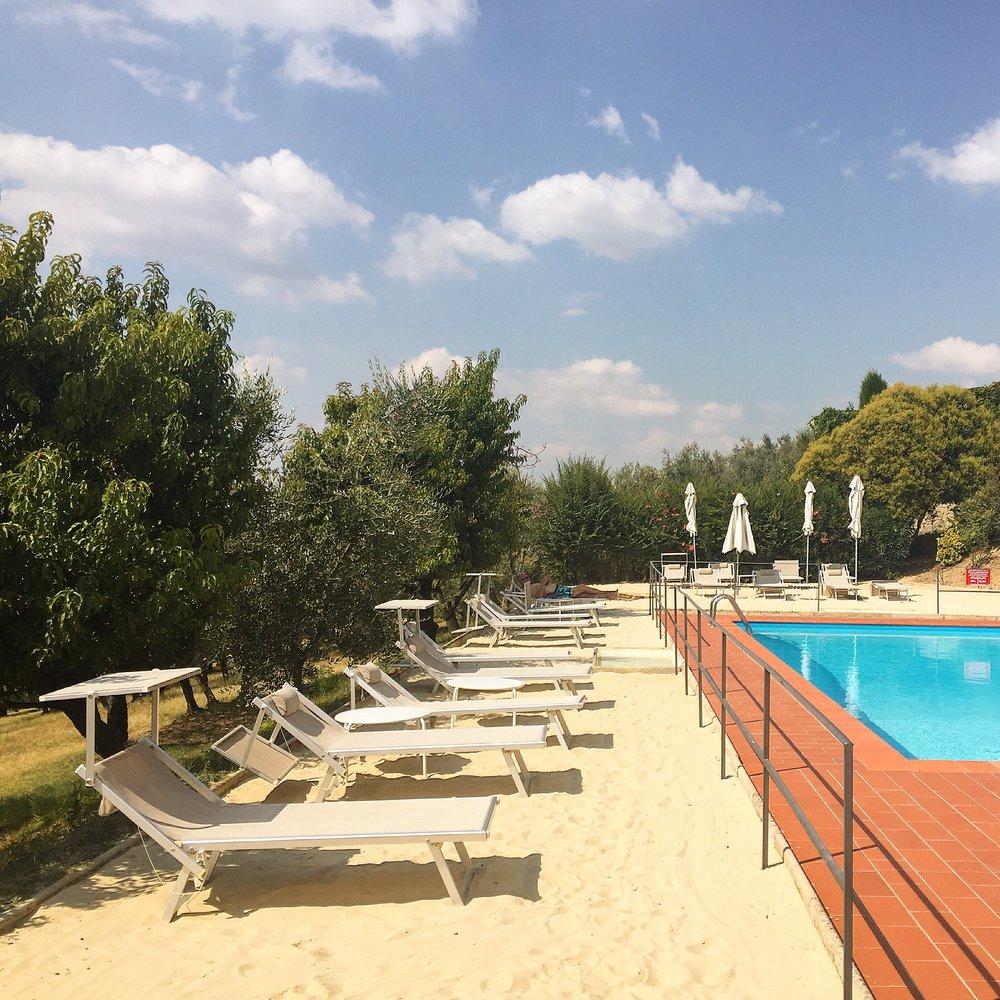 The white sand pool at Relais Villa L'Olmo