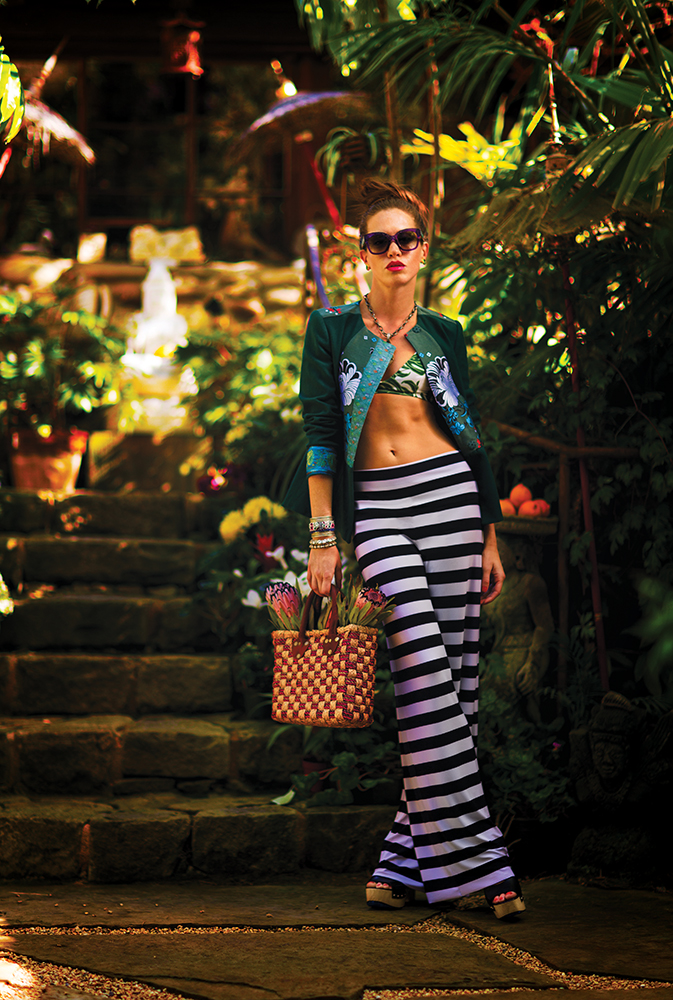 Jacket, necklace and silver bracelets, Antoinette. Pants, Allora by Laura. Sunglasses, Occhiali Fine Eyewear. Bikini top, Bikini Factory. Shoes, Romp. Basket bag, Tienda Ho. Earrings, ARA Collection. Peruvian cuff bracelet, Bonita.