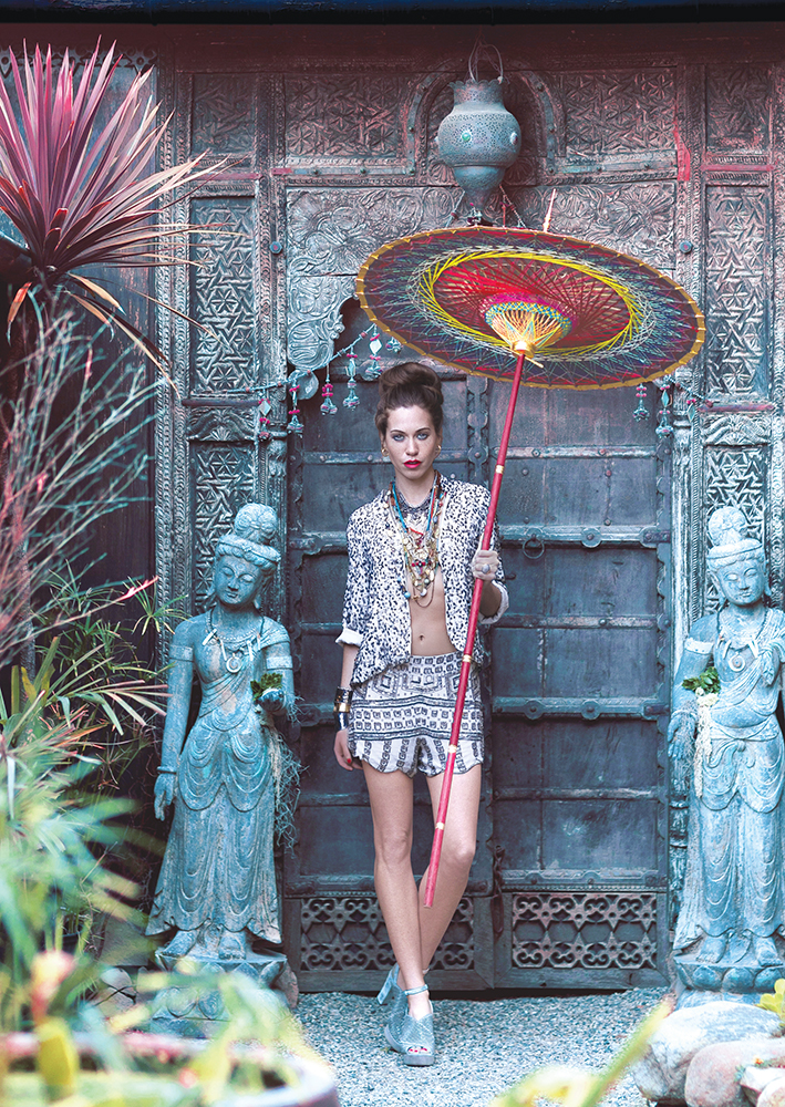 Jacket and shorts, Bonita. Shoes, Romp. Bikini top, Rocha Swim. Layered necklaces from Bonita, ARA Collection and Tienda Ho. Earrings and gold cuff, ARA Collection. Silver cuffs, Gaspar Jewelers.