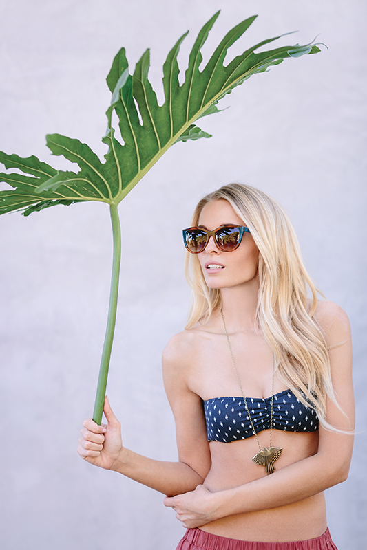 Thierry Lasry sunglasses, Occhiali. Eberjey Soul's Eye bikini top, Bikini Factory. Torchlight Phoenix necklace, Rowan. Hache pull-on skirt, Allora by Laura.