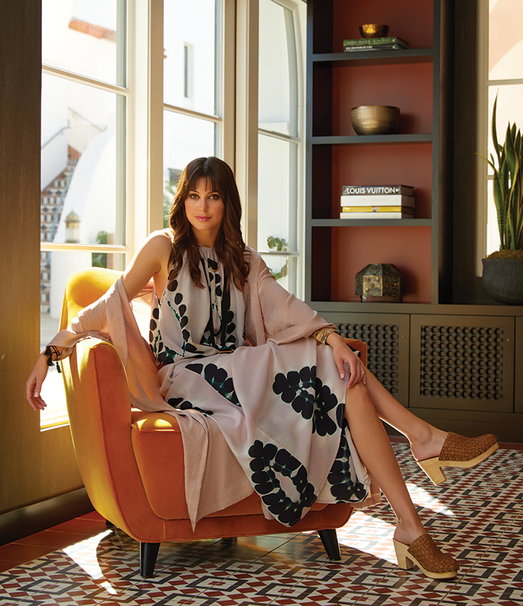 Lounging in the hotel lobby: Dress and beaded bracelets, PLUM GOODS. Kimono robe, ROWAN. Shoes, AMBIANCE. Tassel bracelets and belt, THE SHOPKEEPERS. Necklace, JAKE & JONES.