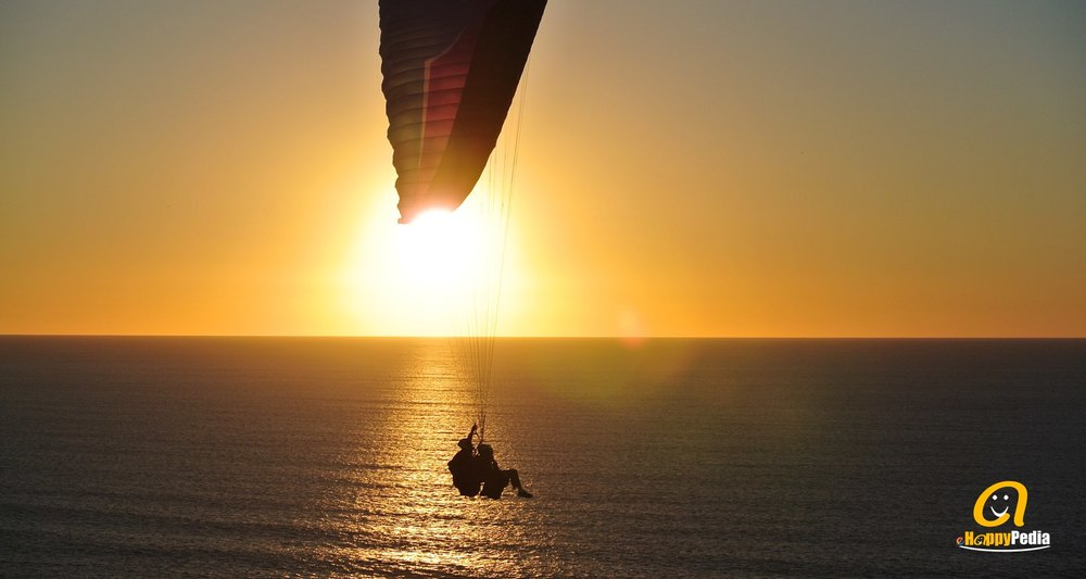 blog - sunset couple flying beach sea.jpeg