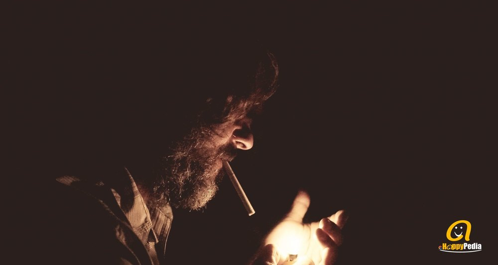 blog - man smoking night light.jpeg