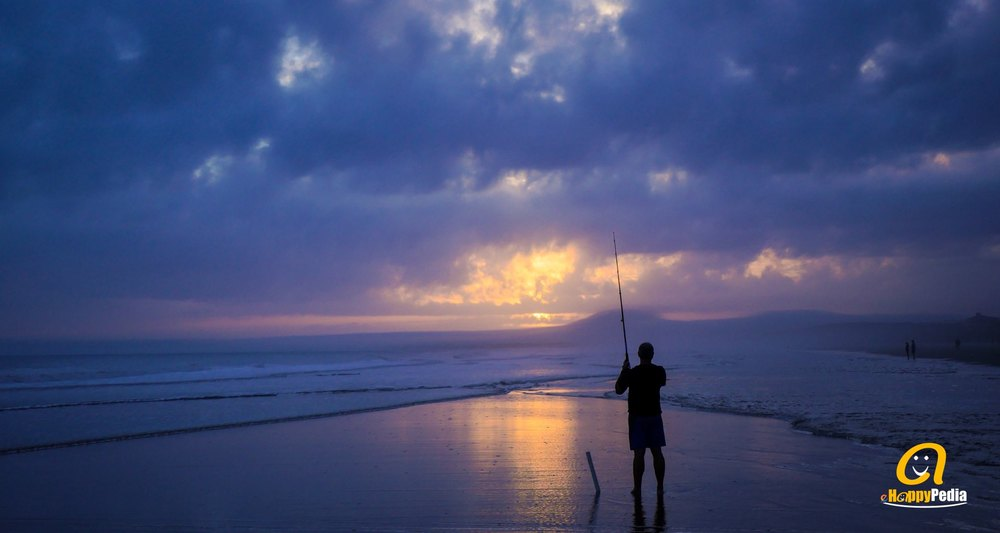 blog - man fishing night beach sea.jpeg