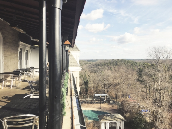 The patio off of Dr. Baker's Lounge includes an impressive view of the Ozark mountains, which is what first inspired architects to build on this site.