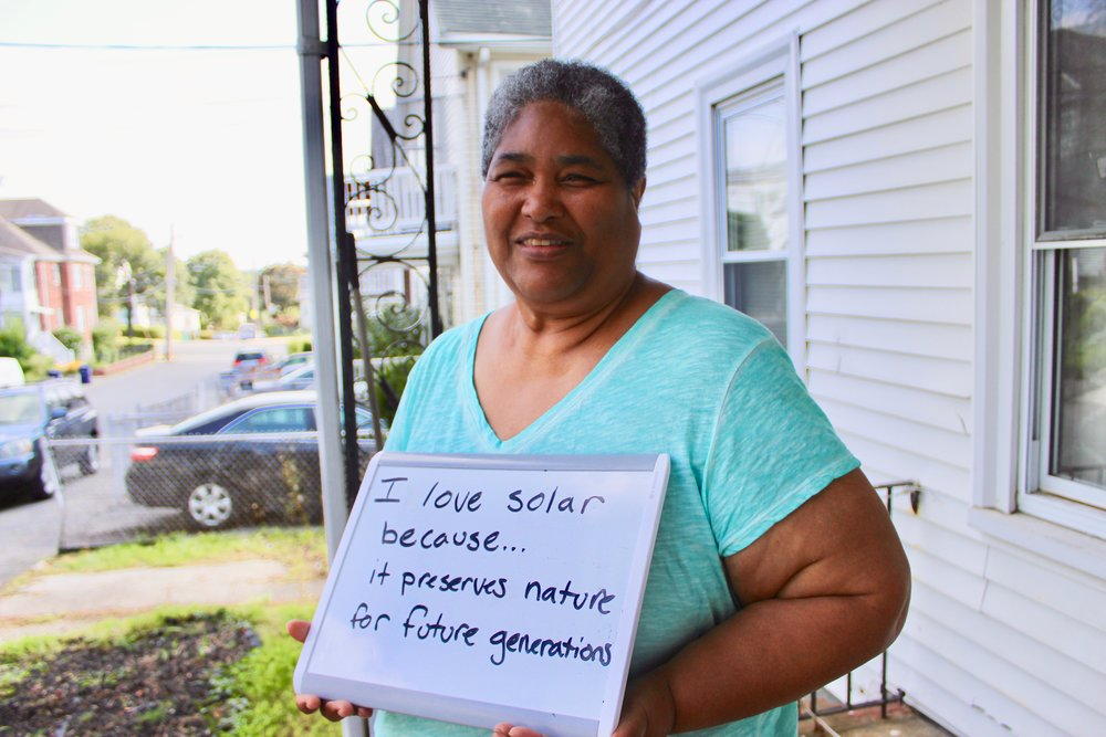 "Dorchester, MA   ""I went solar to save money. We have solar hot water and always wanted to do PV but [it] was out of the affordability range. I think that so many people who could not even think about going solar now have the opportunity to have it. I love solar because it preserves nature for future generations!"""