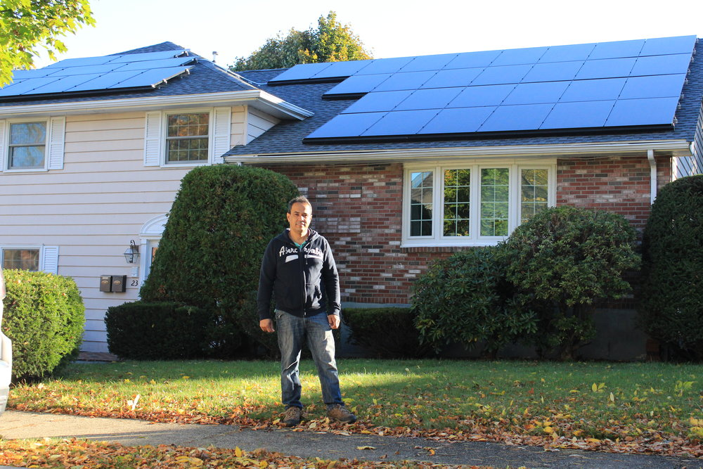 "Stoneham, MA  ""When I bought this house, everything was electric. After the first winter here, I looked at my electricity bill and said, wow no way! I need to get solar! If I was going to go solar, I wanted to own the system. Resonant helped connect me with the MassCEC Solar Loan Program that allowed me own the whole array. Resonant did everything for me and made the process very easy. I love solar because it's clean energy and it saves me money."""