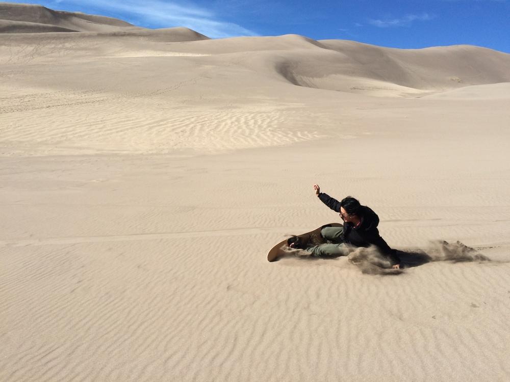 Theresa Sliding across the sand