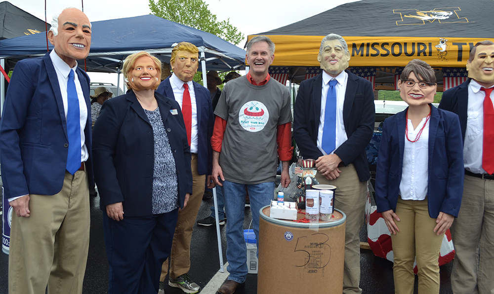 """The Food Bank Board Member Michael Kateman poses with EDI's """"Ship of Fools"""" team members dressed as candidates and politicians."""