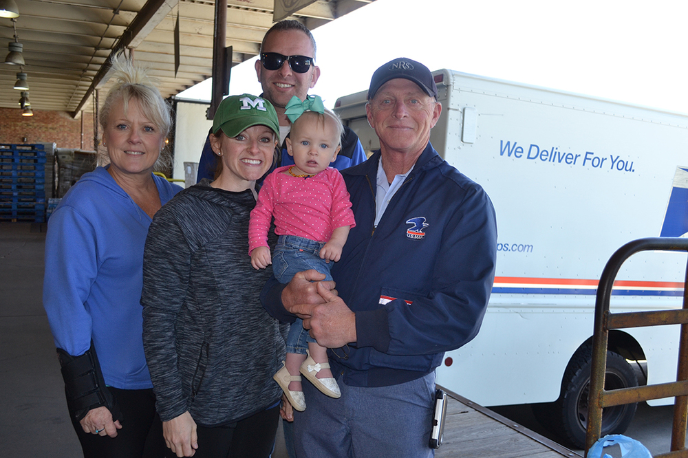 Lindell Lee, right, with daughter, Amanda Quick and granddaughter, Ellie, son-in-law, Sean, and sister Debbie Lee at Stamp Out Hunger in Columbia.