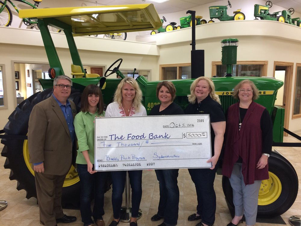 Pictured, from left, are Steve Yager with The Food Bank, Millicent Dawdy, Lee Ann Sydenstricker, Nicole Fleak and Kim Sydenstricker, all with the company, and Susan Dublin with The Food Bank.